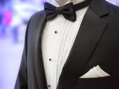 closeup of man wearing black and white tuxedo